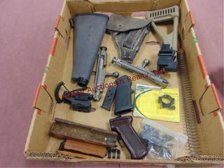 1   box of gun parts  stocks  lazer  holster