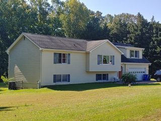 4 BR 2 BA TRI LEVEL HOME ON PRIVATE LOT 2 PARCELS TOTALING 1.1+/- ACRES