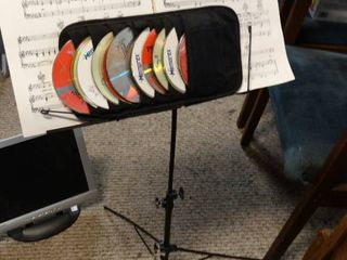 Metal Music Stand with Misc  CDs and Sheet Music