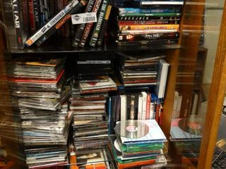 lot of Misc  CDs and DVDs  Bring Box