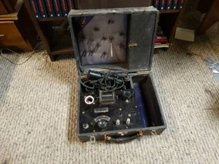Vintage electronic tester in case