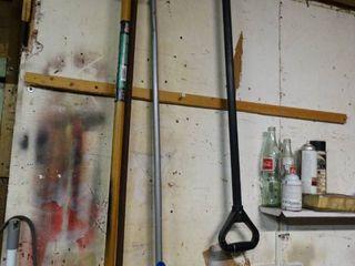 lot of long Handled Tools  Brooms  Shovels  Etc