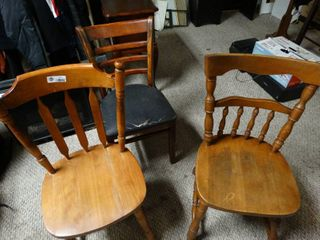 Three wooden chairs two without padding and one with padding