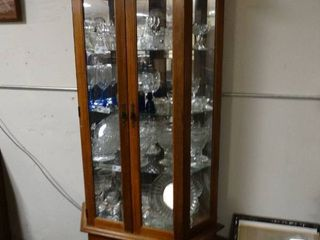 Wood china cabinet with Misc  sets of glass wear