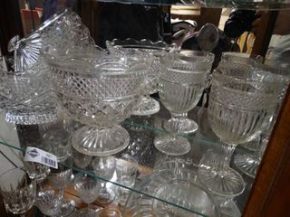 Different designs on the wine glasses and the glass bowls and a glass fan
