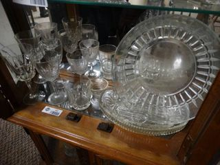 Tall and short wine glasses and liquor glasses and glass plates