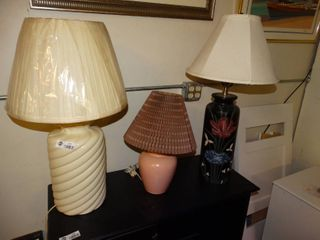 lot of three different styled lamps small medium and large