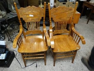 lot of two beautiful wooden chairs with arm rest