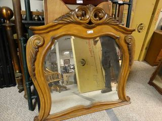 Uniquely shaped wooden framed mirror