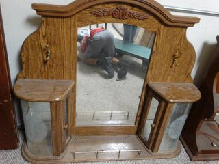 Beautiful wooden framed mirror with glass cubbies and two hooks