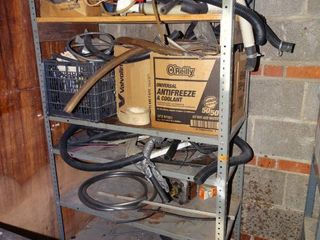 Metal shelf with hardware and other contents