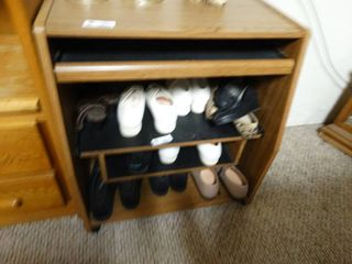 Wooden shelf with pull out compartments