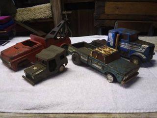 4 Vintage metal toy trucks
