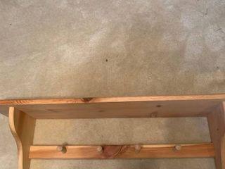 Shelf with coat hooks  cracked