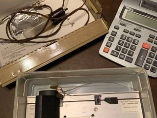 A credit card reader  a box lights and a Casio HR 150 adding machine