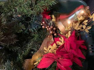 Christmas garland greenery and a small Christmas tree and decor