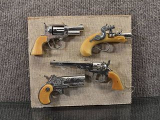 Vintage lot of 4 Mini Toy Guns   One Marked Derringer   Guns Glued to Board   7 25  x 6 5