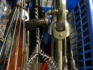 lot of Whisks and kitchen utensils