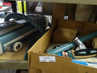 Electrolux Vacuum with Attachments and Books
