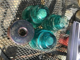 Antique glass insulators great to court three glass and one ceramic as pictured