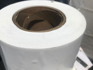 Four rolls of 4 inch white plastic tape