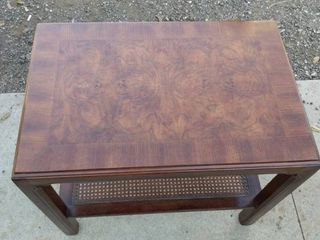 nice wood side table 28 and 1 2 in wide 19 in deep 26 in tall with wicker shelf