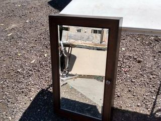 dark cabinet with beveled mirror 20 in wide 34 in tall 5 and 1 2 in deep no shelves