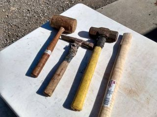 3 hammers and one hammer handle