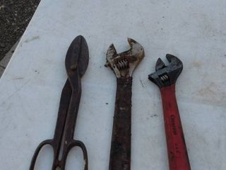 2 crescent wrenches and 1 tin snip