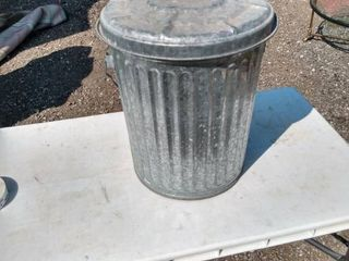 metal trash can with lid full of charcoal