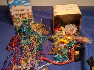 tin can of beads and tin can of jewelry