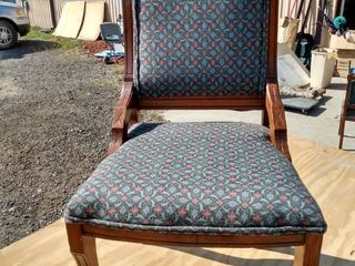 wood and upholstered Victorian chair with wood rollers on front legs
