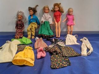 5 dolls with doll clothes
