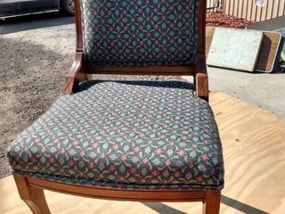 wood and upholstered Victorian chair with wood casters on front legs