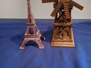 musical windmill that turns and Eiffel tower