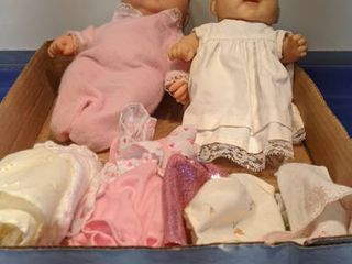 two baby dolls with clothes