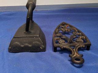 sad iron and cast iron trivet