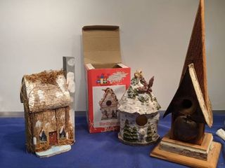 two bird houses and house made out of tree bark