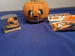 two pumpkins and of two foam shapes