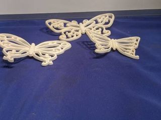 three butterfly plaques