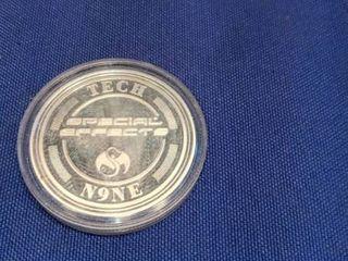tech n9ne strange music coin in capsule