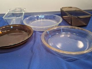 three pie pans and two bread pans