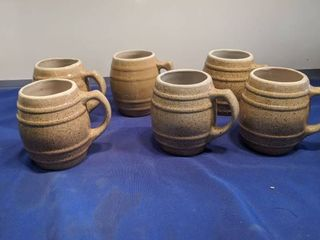 six brown mugs