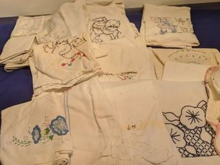 flat of needlepoint tea towels and napkins