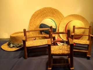 two wooden wicker rocking chairs loveseat and three straw hats