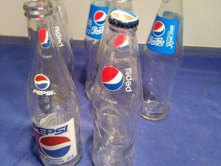seven Pepsi bottles