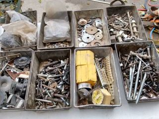 8 metal pans full of nuts bolts and other garage items