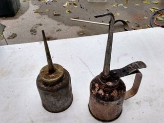 two oil cans 1 is 8 in tall 1 is 9 in tall