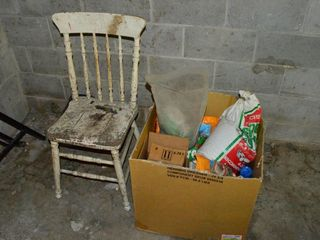 Box of Garden Products and Old Chair