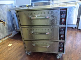 Hatco HDW 3 Freestanding Stainless Steel 3 Drawer Warmer On Casters  Food Pans Not Included